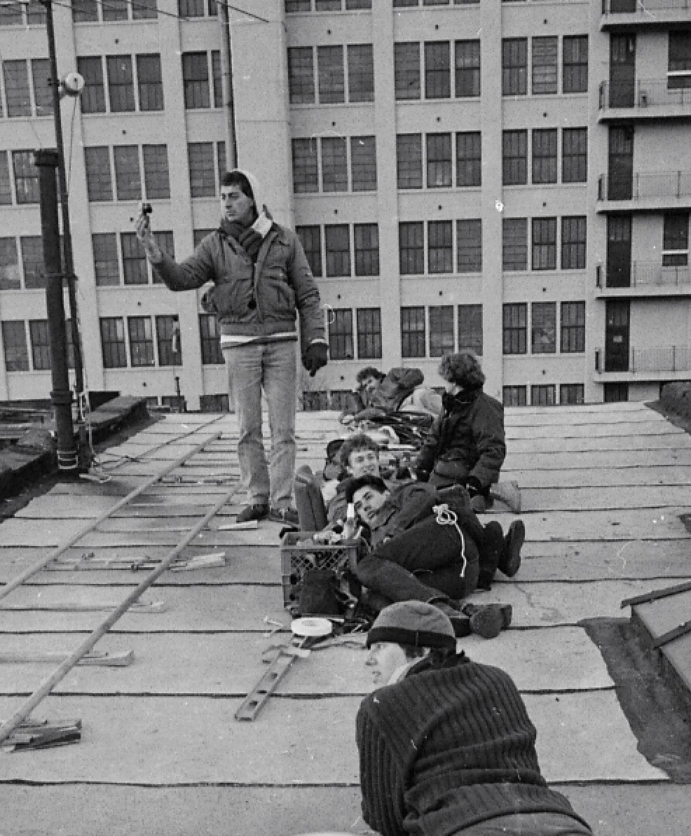 Vladimir Tukan (standing) and crew on the roof to get the end credits shot  photo by Warner Dick