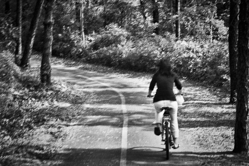 Jen riding bicycle Honeymoon.jpg