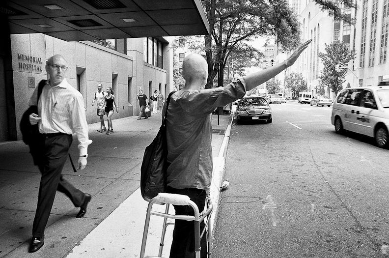 Jen hailing a cab outside of hospital.jpg