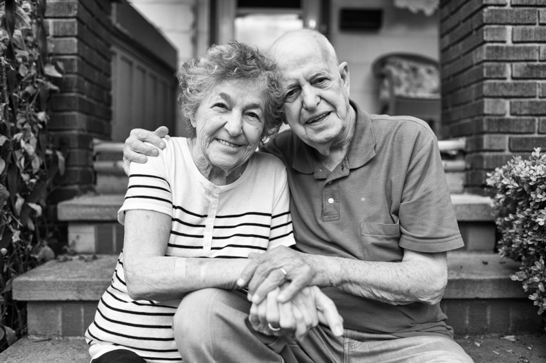 7_28_2013 Mom and Dad on front porch BW.jpg