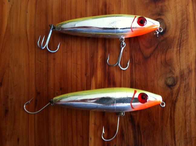 Before and after, top plug has the old treble hooks, six total points to penetrate the fish, as opposed to the bottom plug which has converted to single hooks.