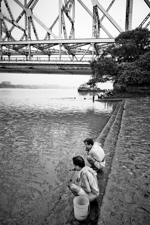 Howrah Bridge hanging over the Hooghly, Mallick Ghat, Kolkata.