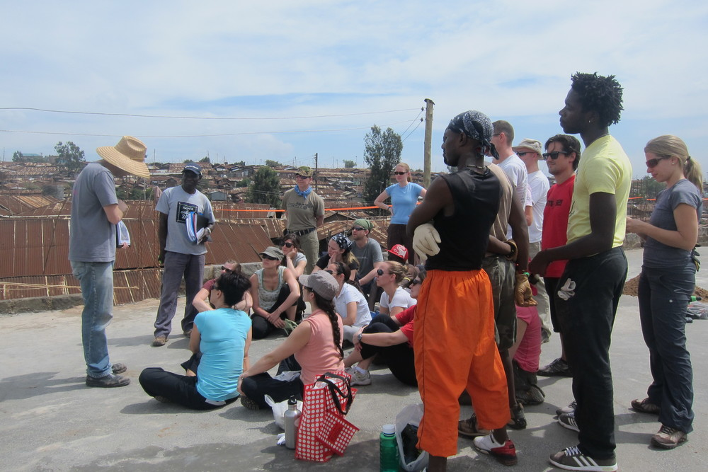 Seva Safari's first day on KSG's roof. John, from Playground Ideas, explains the playground design