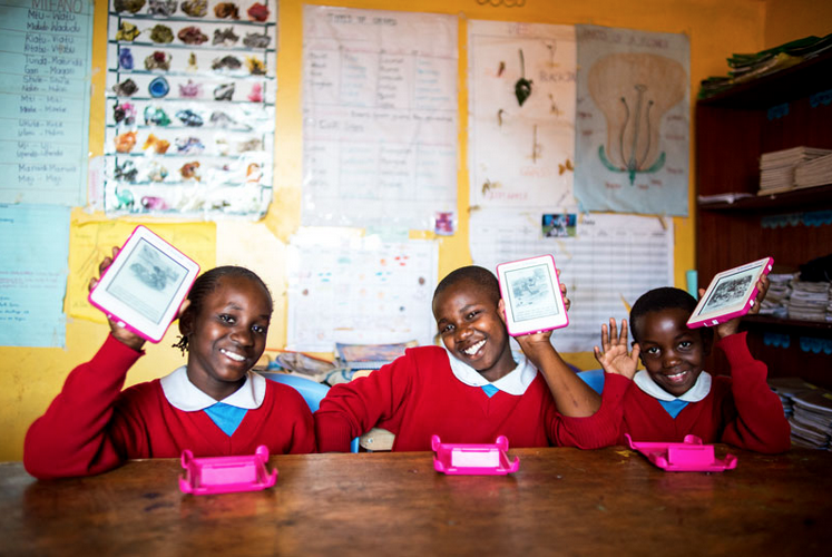 Big smiles from the girls at the Kibera School for Girls as they receive 5,000 life-changing e-books.