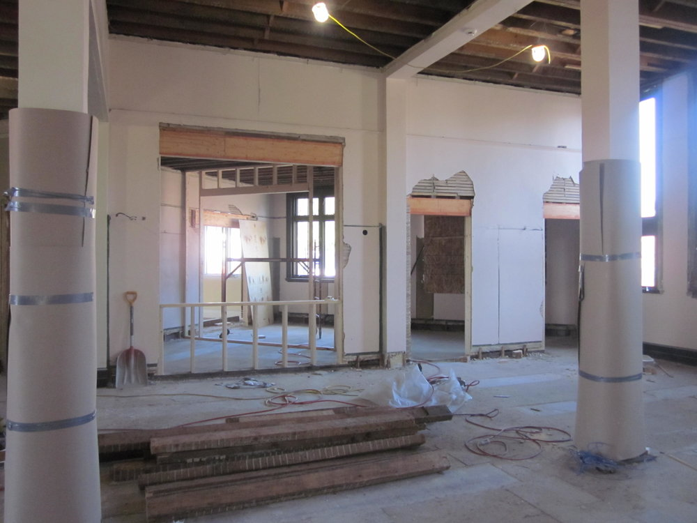 Looking toward the new circulation area into a staff workroom, restrooms and a new meeting room