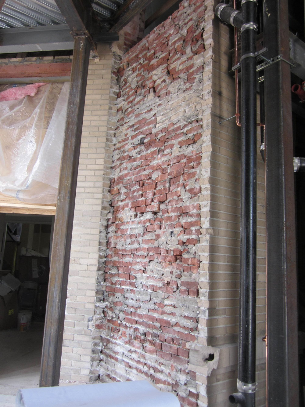 Exposed historic brick inside the exterior brick
