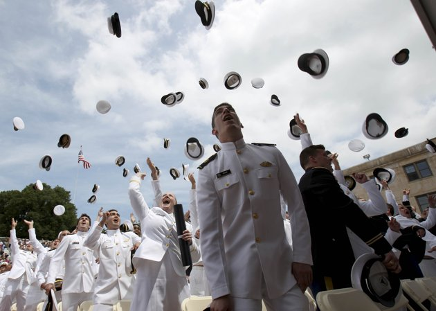 graduates-of-the-United-States-Merchant-Marine-Academy-toss-their-hats-in-the-air-to-celebrate-their-graduation-in-Kings-Point-N.Y..jpg