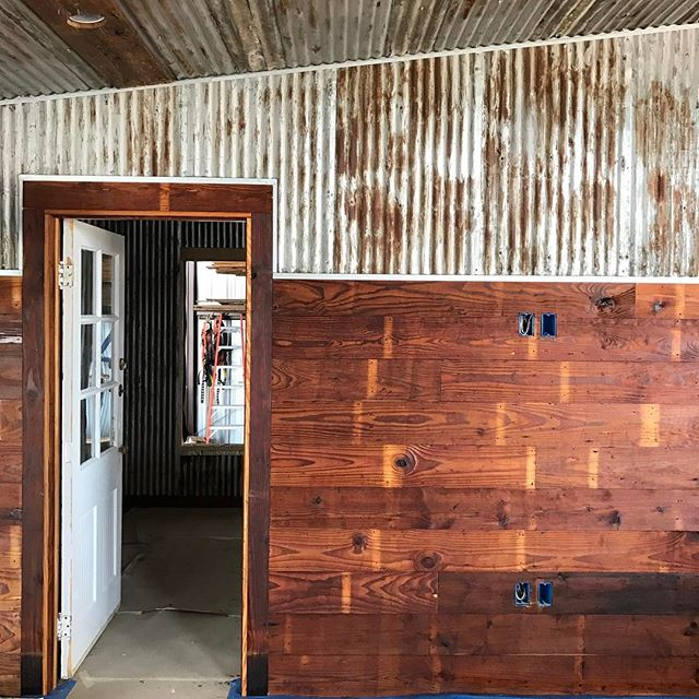 The house is coming together perfectly! Just look at how spectacular that wide corrugated metal looks against the reclaimed shiplap! In further news, the kitchen is undergoing some major changes so stick around for more progress shots of the the Oakhill house!