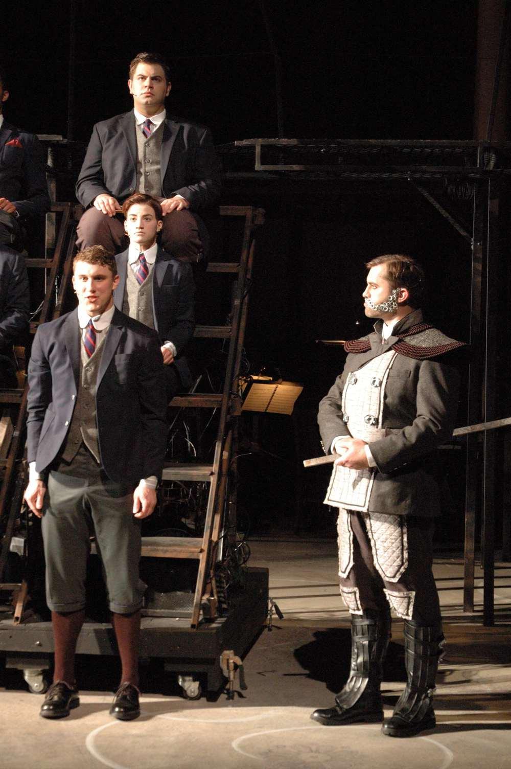 Herr Knochenbruch (Adam Thatcher) reprimands Melchior Gabor (David Kaplinsky)