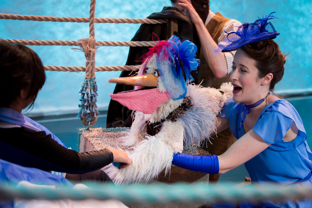 Flow Fogg (Leigh Poulos) sings with a Pelican from the Arctic Aviary