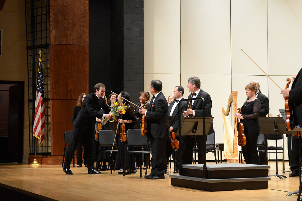 Vladimir shaking hands with orchestra.jpg