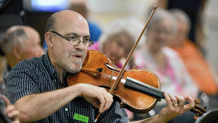 Daniel Golden plays the viola at Lake Forest Place. Four musicians from the Lake Forest Symphony were at the retirement community, performing for residents in the memory care unit. (Brian O'Mahoney / Pioneer Press)