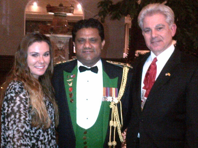 Mr. Roberto Miranda, IALPAE Director for Intergovernmental and External Affairs, poses with his daughter and the Sri Lankan ambassador during a celebration of Sri Lanka's 67 years of independence.