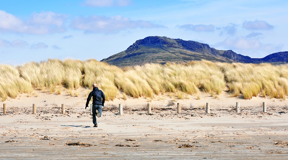 ...couldn't find a photo of me running... so my brother running on a beach in winter a couple of years back is the best I have ;-)