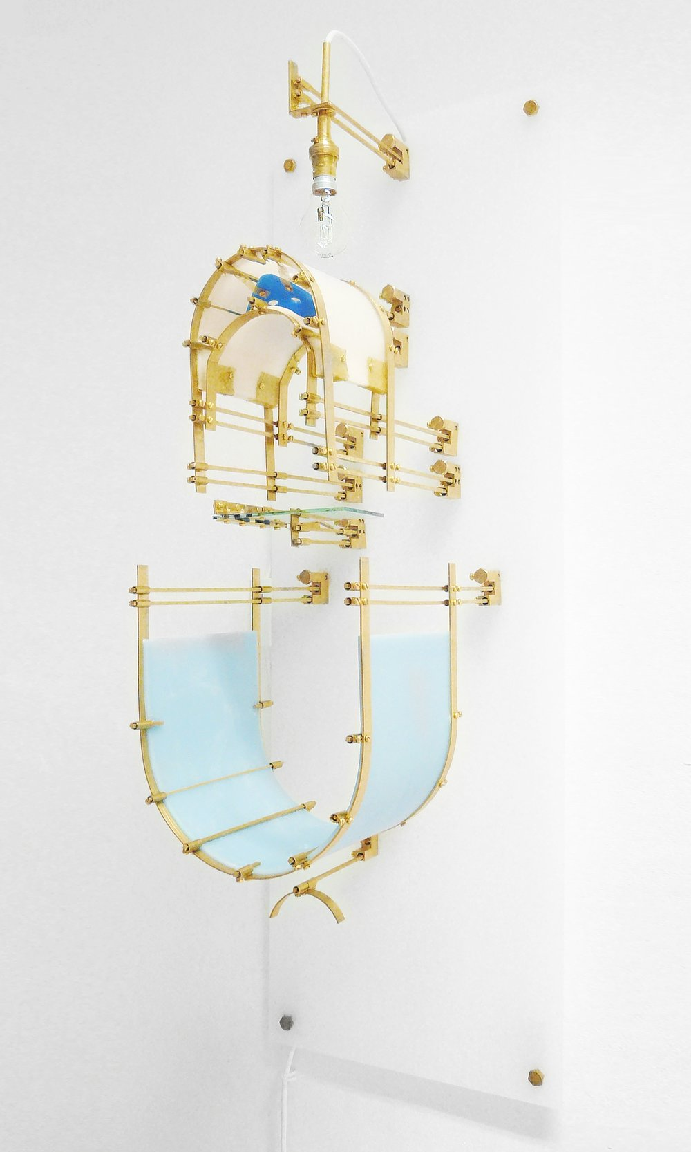 The Apparatus. Touching the Beyond.  Brass, wax, light bulb, mirror  120 x 45 x 45 cm 2011  1 AP  Chelsea College of Art & Design London, UK  Images: Anya Mokhova Studio