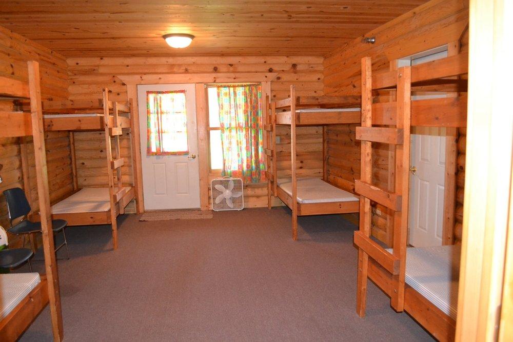 each cabin sleeps 8
