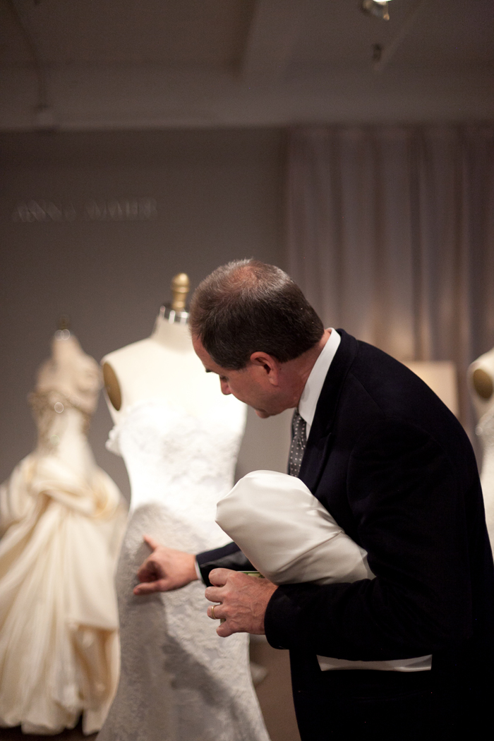 Charles, the designer/owner of Anna Maier, shows anna bé a detail on a gown - Photography by Laura Dombrowski of COUTUREcolorado