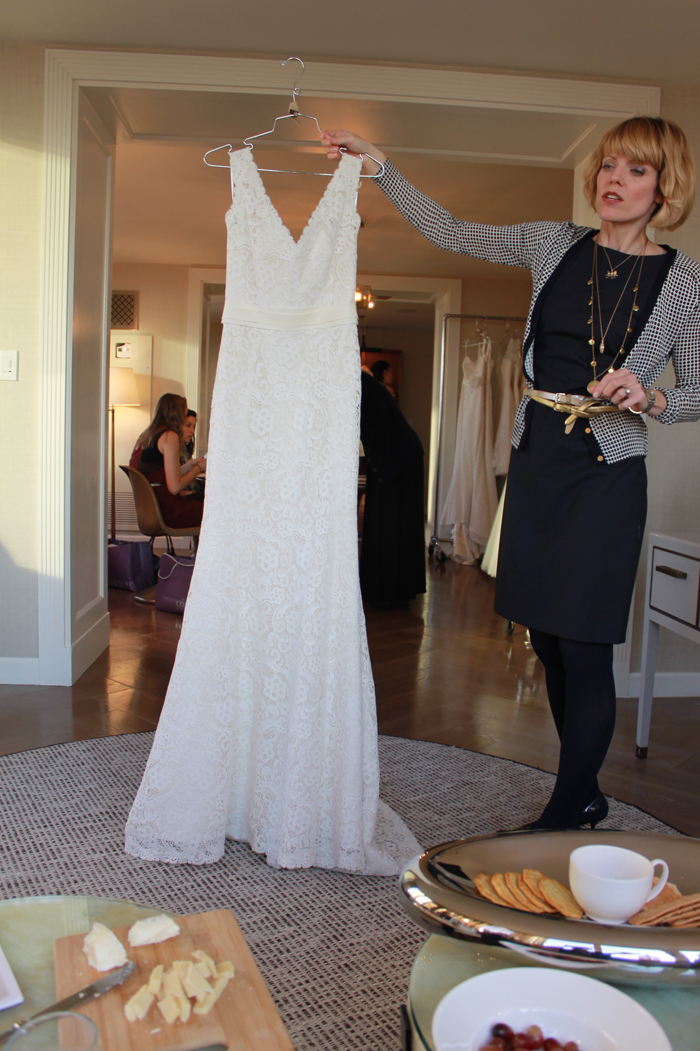 Amy Kuschel herself shows the anna bé team a dress from her newest collection