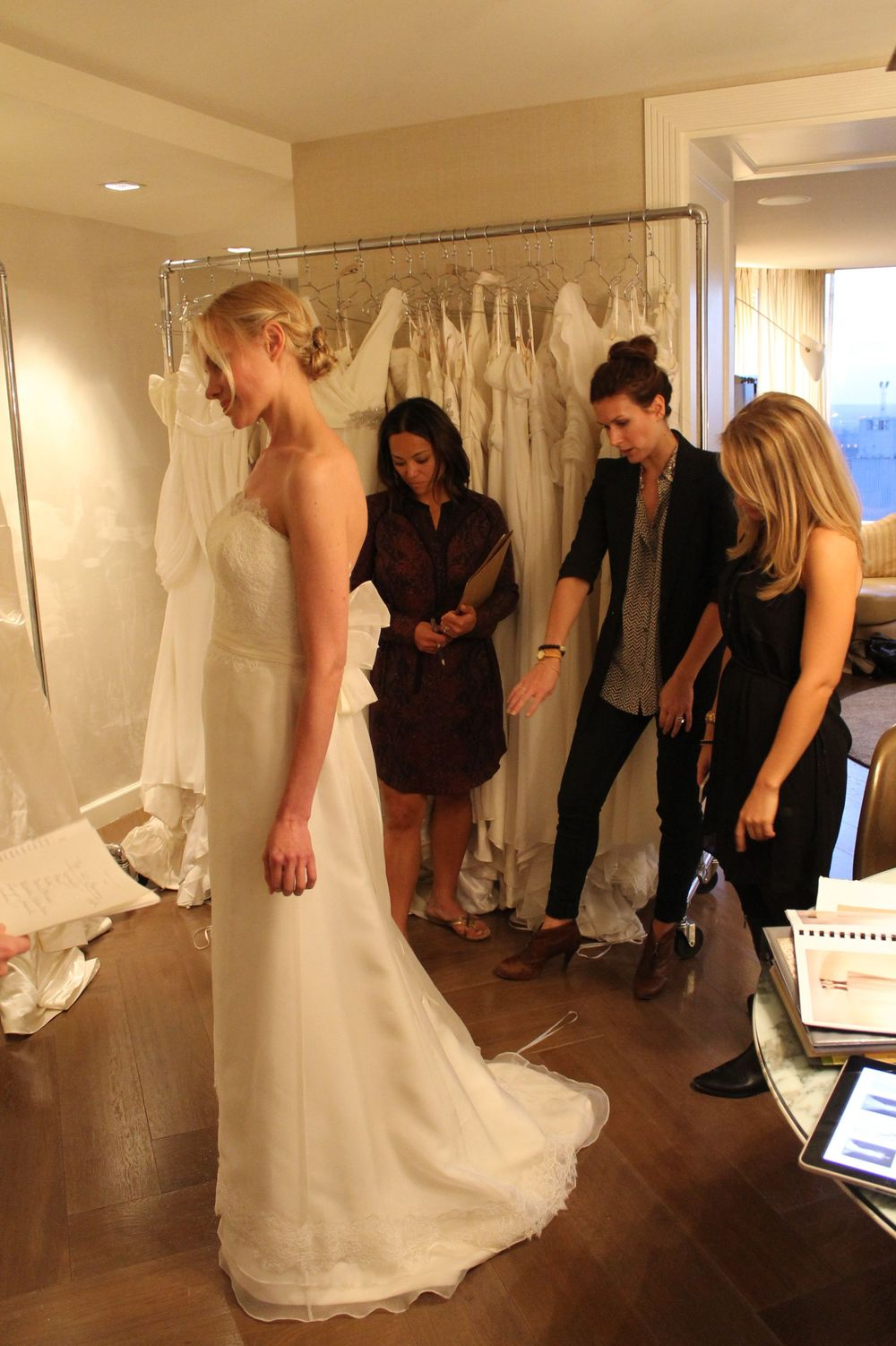 Anna, Chelsea, and Melissa discuss an Amy Kuschel gown at The London hotel