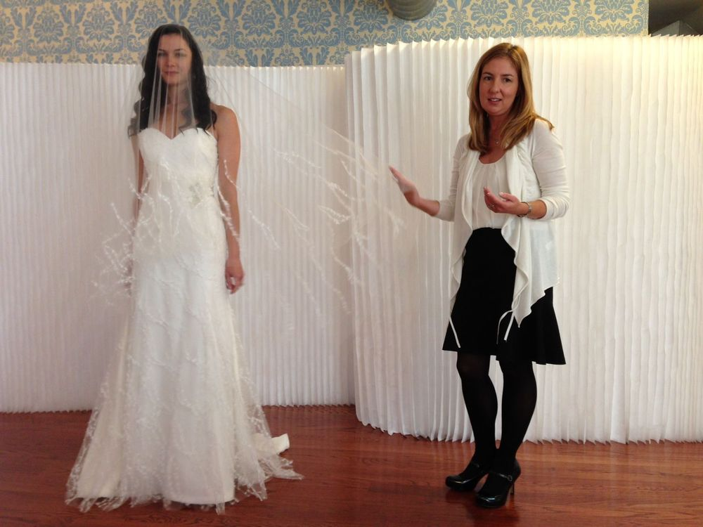 Next, we visited Modern Trousseau's showroom that is also in the fashion district in NYC. Cassie, the designer for Modern Trousseau, shows us a gown and veil design from her newest collection.