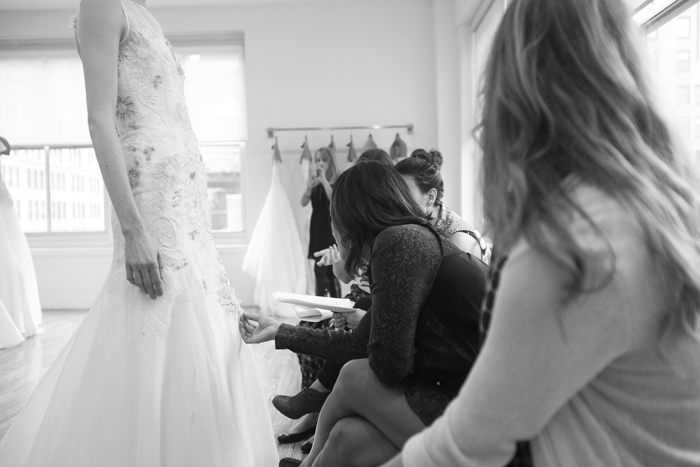 The anna bé team taking an up close look and feel of the fantastic detail of this Lela Rose gown - Photography by Laura Dombrowski of COUTUREcolorado