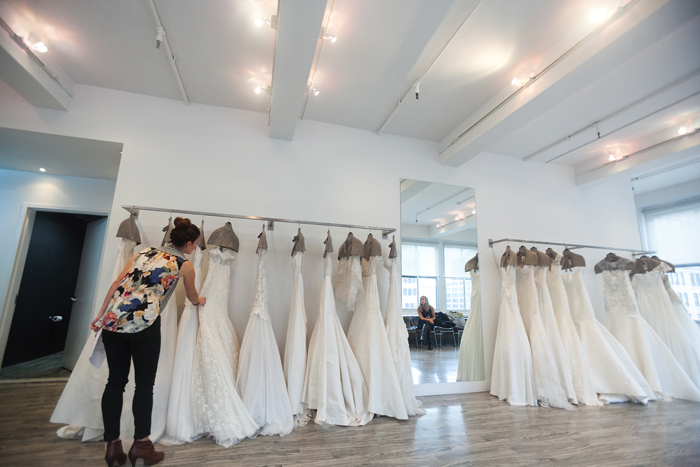 Chelsea admiring the Lela Rose gowns - Photography by Laura Dombrowski of COUTUREcolorado