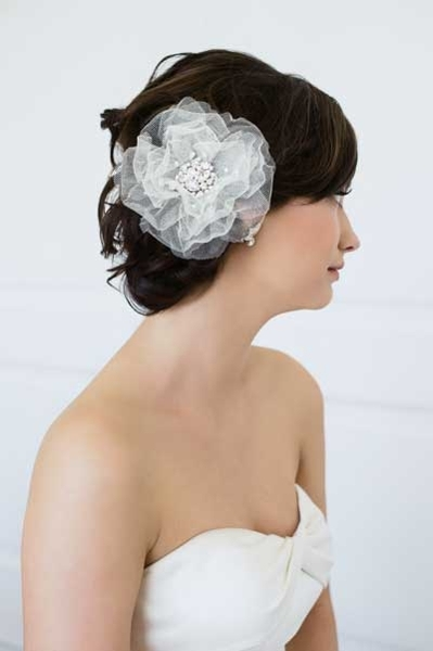 I love the Judy flower!  From far away it has an ethereal look with just a touch of sparkle, but as you get closer to the bride you realize that this is kind of a rockstar piece.  The texture created by the starchy net fabric of the petals is so cool!  - Joy