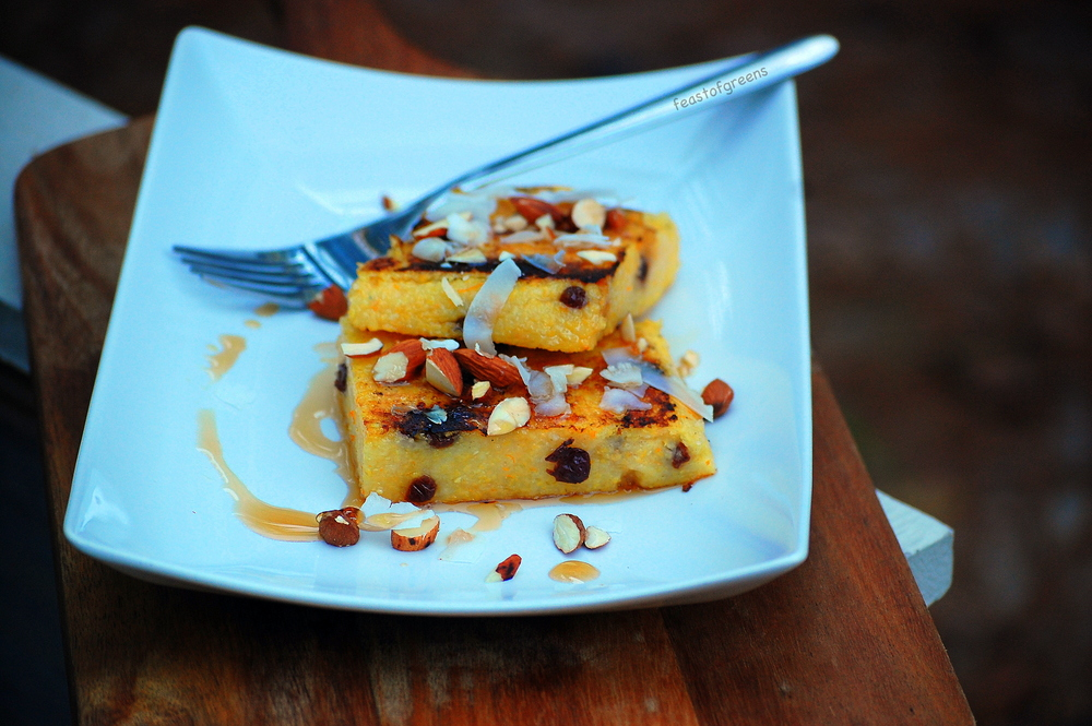 Breakfast polenta cakes with maple syrup, coconut and almonds