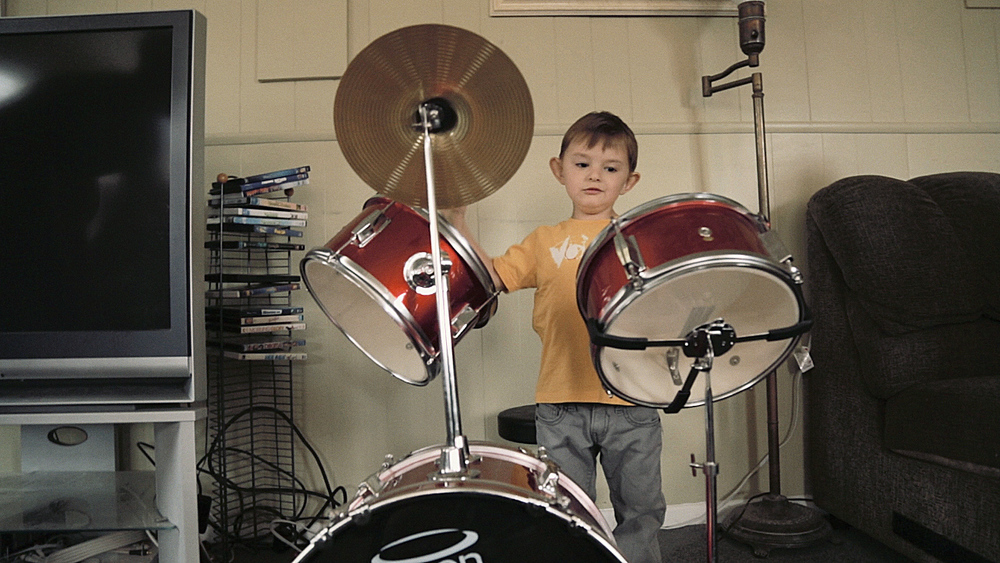 Calvin playing his drums.