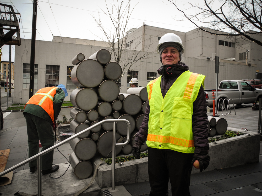 Jenny proudly wearing her hard hat and safety vest!