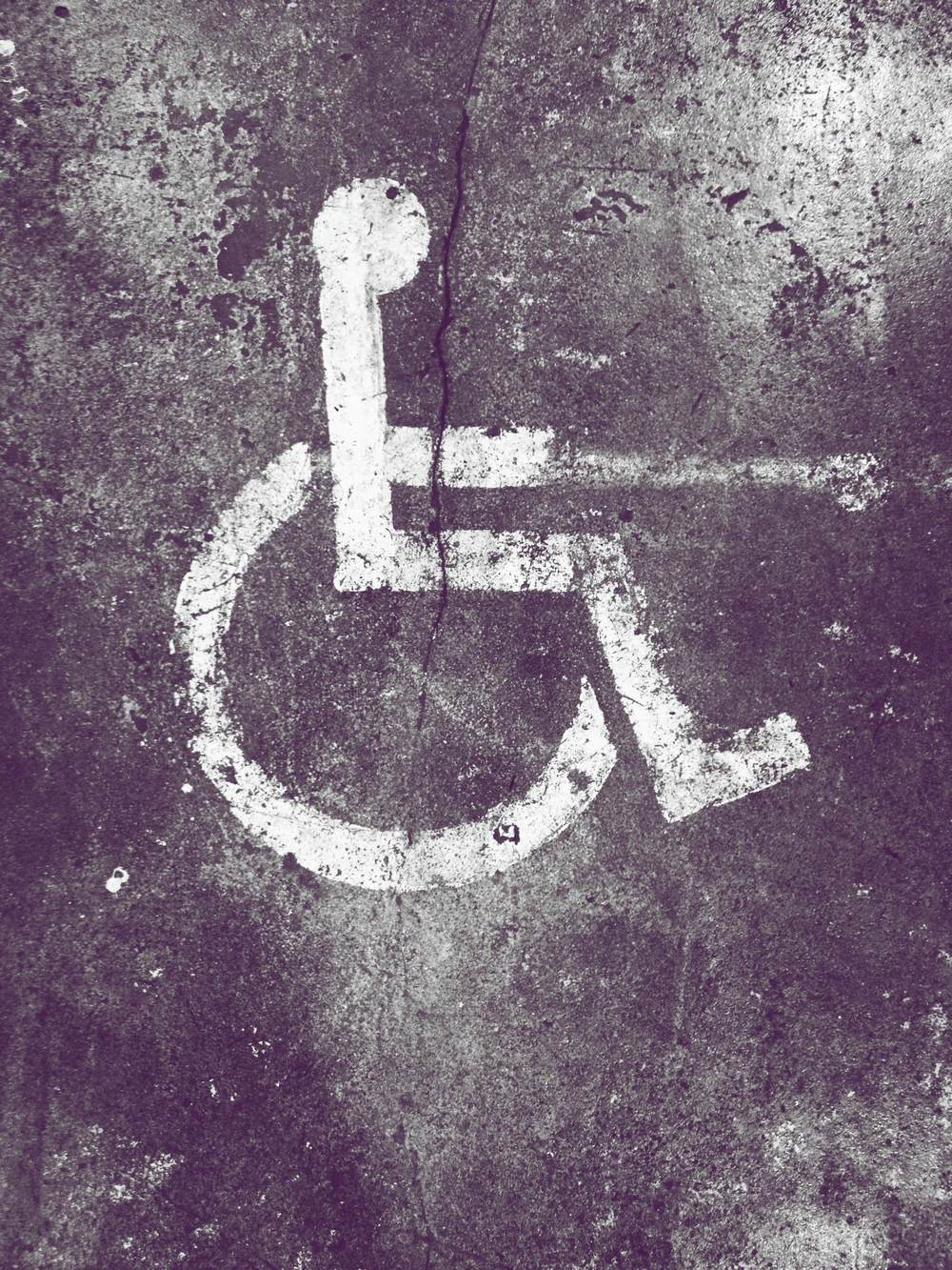 iphone photography handicap sign on concrete.jpg