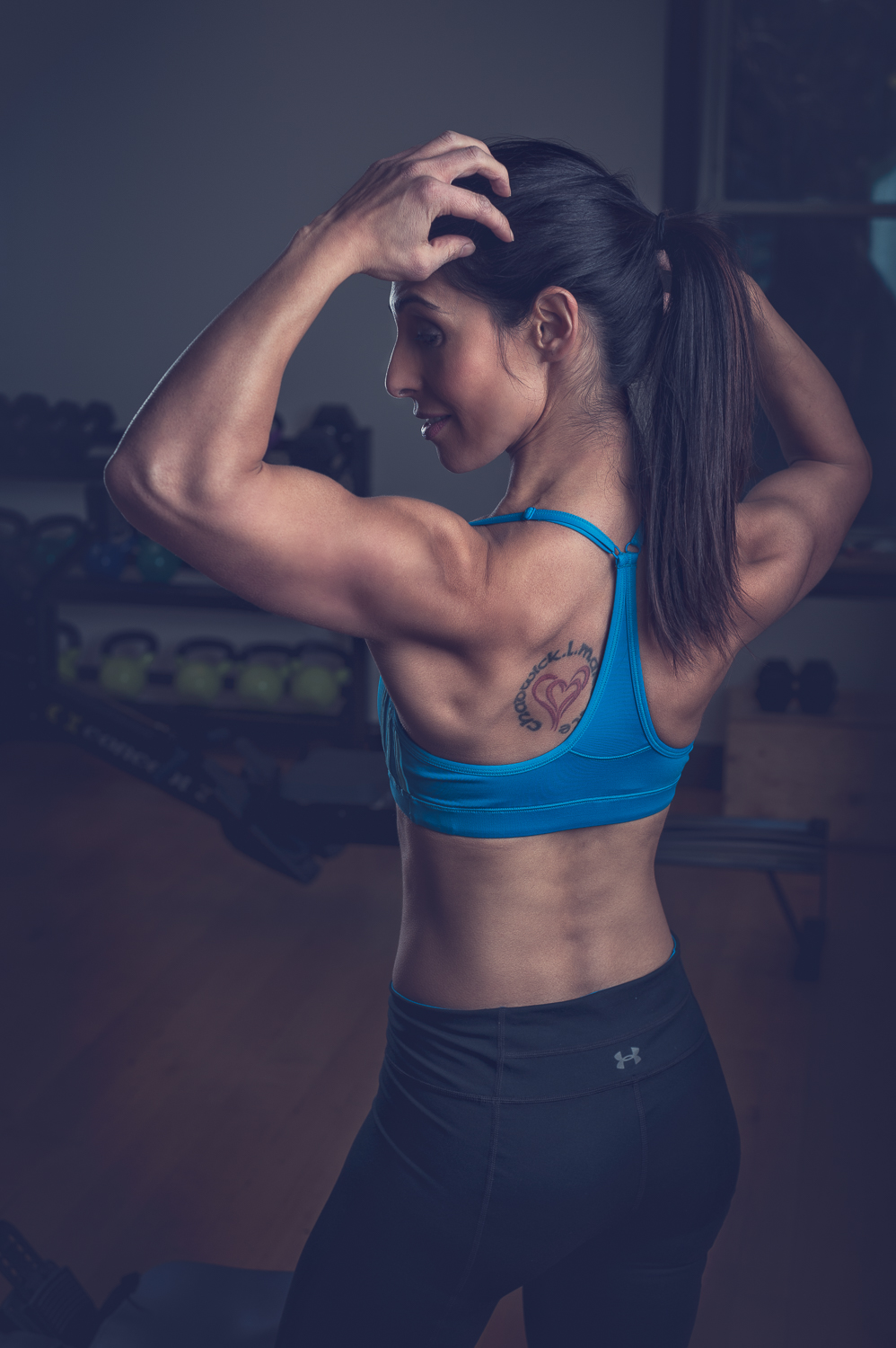 Hamilton Toronto Fitness Photographer - Flexing Female Model by Marek Michalek.jpg