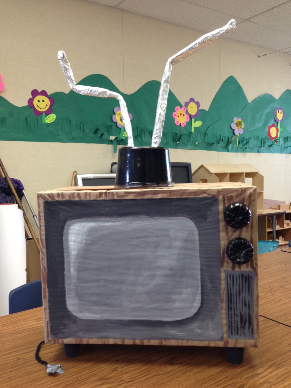 This is a cardboard TV i was asked to make for no screens week.  I don't know what has become of it I suggested they used it as a pinata and have TV Guide pages come out.