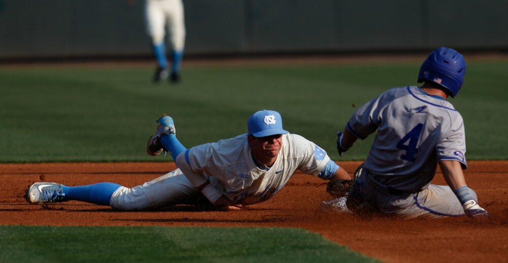 North Carolina freshman Ashton McGee tags out Florida Gulf Coast's Richie Garcia.