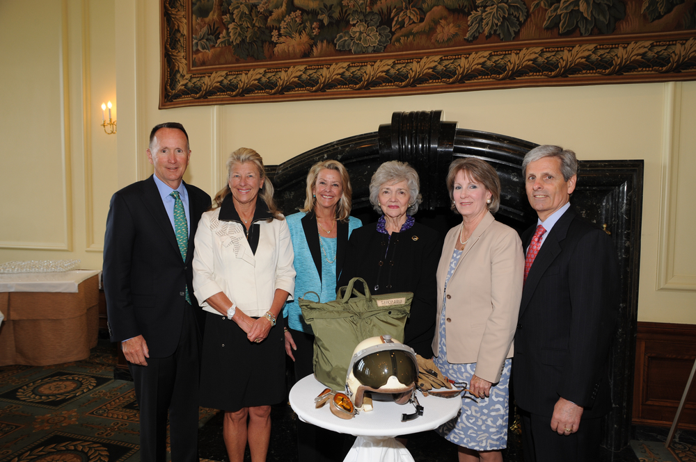 Members of Admiral Shepard's family with Marilyn Lovell. Several ofAdmiralShepard's personal items (pictured), along with his flight suit, have been generously loaned to the museum by his family and are currently on display.