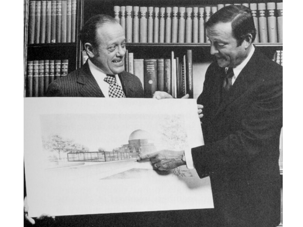 Director Joe Chamberlain shows a preliminary sketch for the design of the Adler addition, c. 1970.