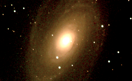 (Figure 2) Spiral galaxy M81 photographed by Adler astronomer, Larry Ciupik, from the Doane Observatory showing effects of varying light pollution.