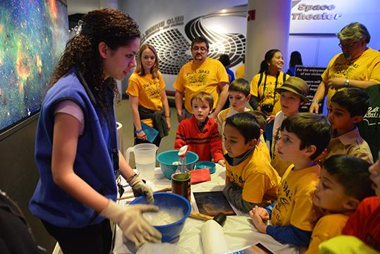 Adler Volunteer helps kids during an overnight activity.