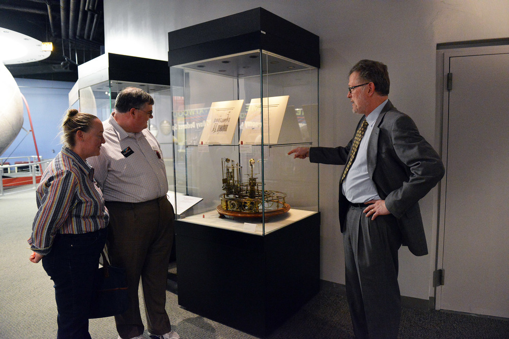 Curator Bruce Stephenson discusses Planetary Machines with Adler members.