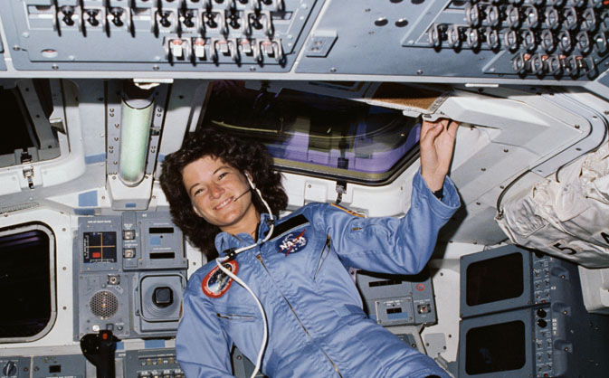 STS-7 Mission Specialist Sally Ride poses on aft flight deck with her back to the onorbit station. Image Credit: NASA