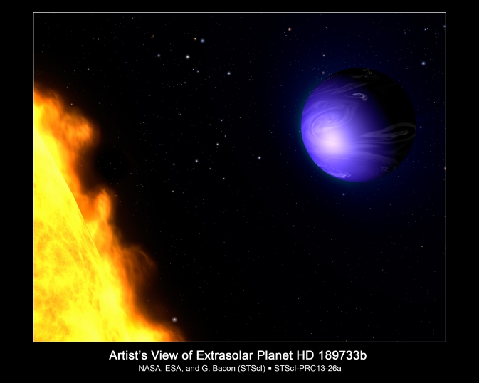 This artist's concept shows exoplanet HD 189733b orbiting its yellow-orange star, HD 189733. NASA's Hubble Space Telescope measured the actual visible-light color of the planet, which is deep blue. Image Credit: NASA, ESA, and G. Bacon (STScI)
