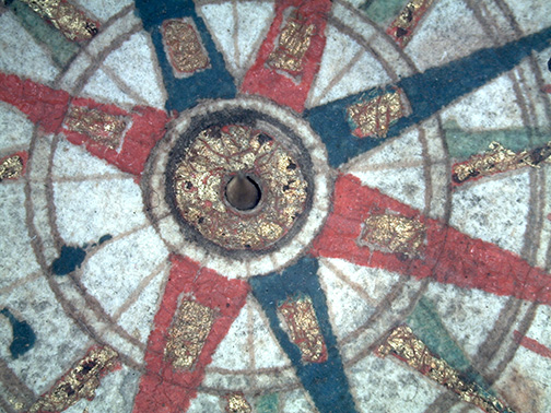 Microscope image of compass rose for M-254. The image shows pigment stability and areas where gold leaf was lost.