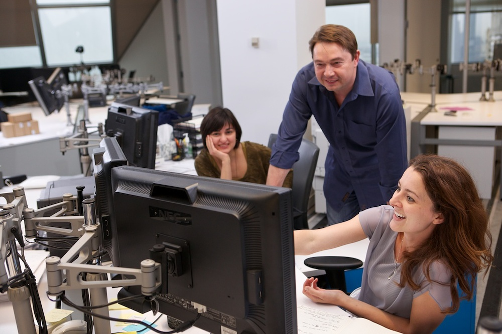 Misha withTeza employees.jpg