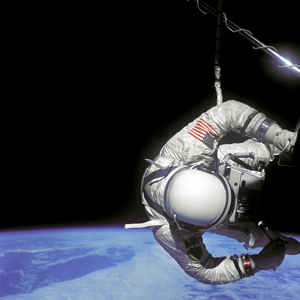 Edwin E. Aldrin Jr., pilot of the Gemini 12 spacecraft performs extravehicular activity (EVA) during the second day of the 4-day mission in space. Aldrin is positioned next to the Agena work station. Image from GRIN, courtesy of NASA. NASA identifier: S66-62782.