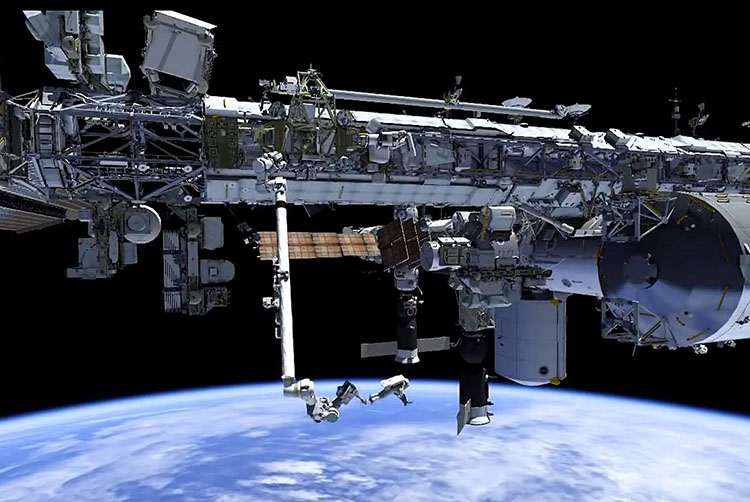 NASA astronauts are performing spacewalks to repair a faulty cooling pump on the outside of the International Space Station. Credit: NASA TV