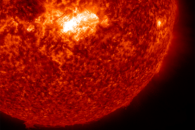 A mid-level solar flare erupted on the sun late on Feb. 3, 2014, peaking at midnight EST. This image, captured by NASA's Solar Dynamics Observatory, shows the bright flare near the center of the sun. Image Credit: NASA/SDO