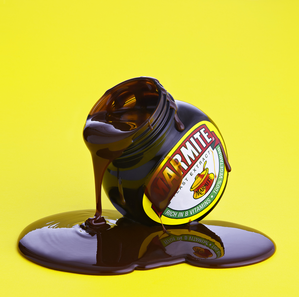 Food and drink photographer and tabletop director Scott Grummett based in London. Shooting Advertising, editorial, packaging, pr and more. Shown here is food photography from food photographer and director Scott Grummett of Marmite still life yellow background dripping pouring thick syrup texture graphic