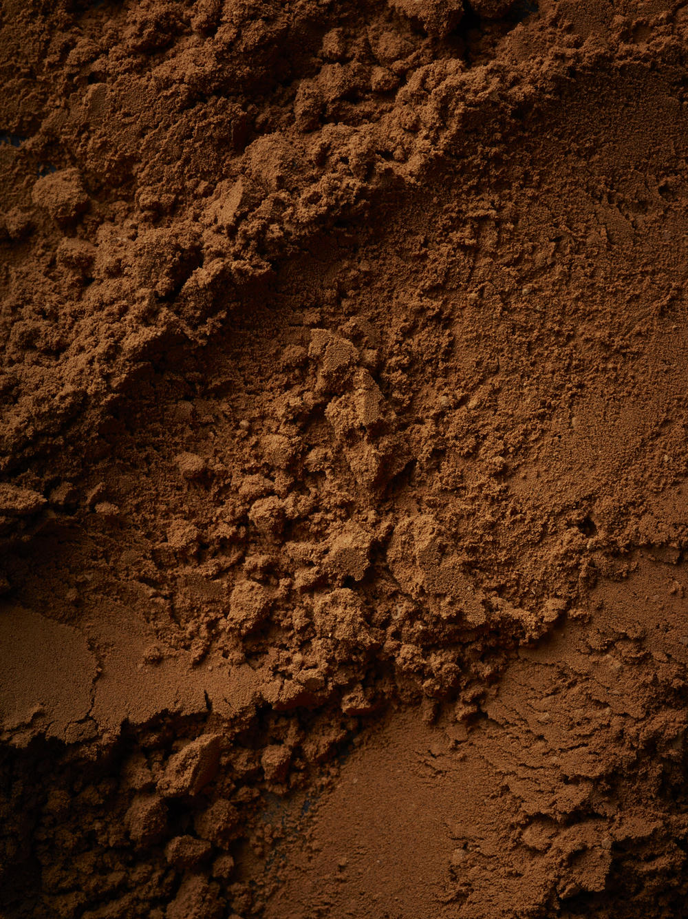 Food and drink photographer and tabletop director Scott Grummett based in London. Shooting Advertising, editorial, packaging, pr and more. Shown here is food photography from food photographer and director Scott Grummett of   chocolate, cocoa, raspberry, fondue dip melted gloss, cocoa powder