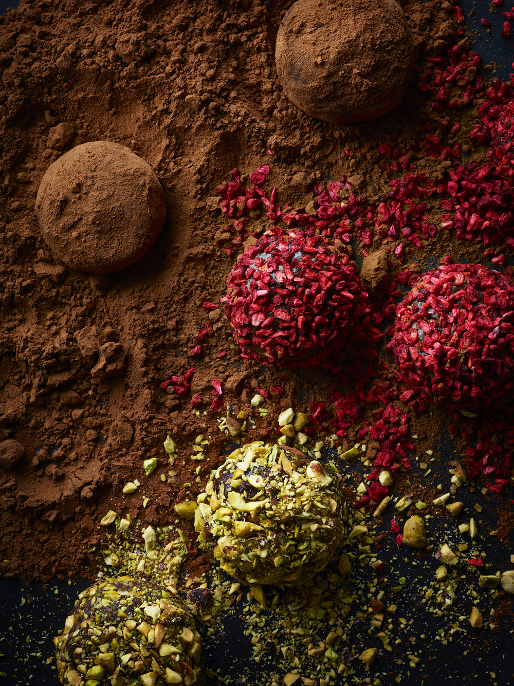 Food and drink photographer and tabletop director Scott Grummett based in London. Shooting Advertising, editorial, packaging, pr and more. Shown here is food photography from food photographer and director Scott Grummett of   chocolate, cocoa, raspberry, fondue dip melted gloss, cocoa powder, truffle truffles pistachio raspberry