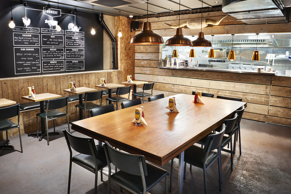 Interiors at Honest Burger's new location in Liverpool Street. Imagery and Photography by London based still life and food photographer Scott Grummett